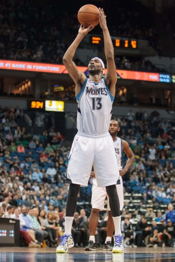 Apr 11, 2014; Minneapolis, MN, USA; Minnesota Timberwolves forward Corey Brewer (13) hits his 51st point on a free throw in the fourth quarter against the Houston Rockets at Target Center. The Minnesota Timberwolves win 112-110. Mandatory Credit: Brad Rempel-USA TODAY Sports