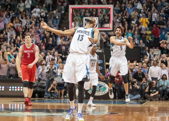 Apr 11, 2014; Minneapolis, MN, USA; Minnesota Timberwolves forward Corey Brewer (13) celebrates his 51 point night aft the end of the fourth quarter against the Houston Rockets at Target Center. The Minnesota Timberwolves win 112-110. Mandatory Credit: Brad Rempel-USA TODAY Sports