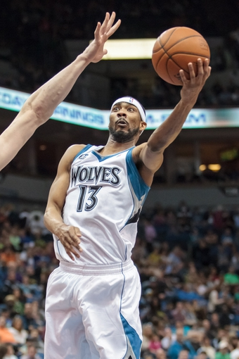 Apr 11, 2014; Minneapolis, MN, USA; Minnesota Timberwolves forward Corey Brewer (13) shoots in the third quarter against the Houston Rockets at Target Center. The Minnesota Timberwolves win 112-110. Mandatory Credit: Brad Rempel-USA TODAY Sports