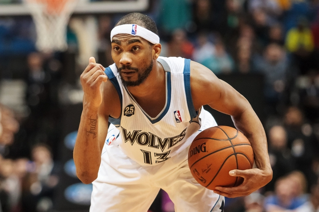 Apr 11, 2014; Minneapolis, MN, USA; Minnesota Timberwolves forward Corey Brewer (13) in the fourth quarter against the Houston Rockets at Target Center. The Minnesota Timberwolves win 112-110. Mandatory Credit: Brad Rempel-USA TODAY Sports
