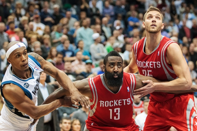 Apr 11, 2014; Minneapolis, MN, USA; Minnesota Timberwolves forward Dante Cunningham (left) Houston Rockets guard James Harden (13) and Houston Rockets forward Chandler Parsons (right) rebound in the fourth quarter at Target Center. The Minnesota Timberwolves win 112-110. Mandatory Credit: Brad Rempel-USA TODAY Sports