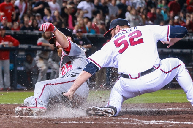 Apr 11, 2014; Atlanta, GA, USA; Atlanta Braves relief pitcher Jordan Walden (52) tags out Washington Nationals first baseman Adam LaRoche (25) in the seventh inning at Turner Field. The Braves won 7-6. Mandatory Credit: Daniel Shirey-USA TODAY Sports