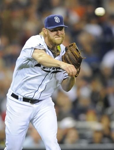 Apr 11, 2014; San Diego, CA, USA; San Diego Padres starting pitcher Andrew Cashner (34) throws to first for the final out of the fourth inning against the Detroit Tigers at Petco Park. Mandatory Credit: Christopher Hanewinckel-USA TODAY Sports