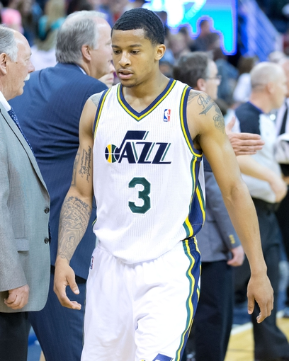 Apr 11, 2014; Salt Lake City, UT, USA; Utah Jazz guard Trey Burke (3) leaves the court after losing to the Portland Trailblazers 111-99 at EnergySolutions Arena. Mandatory Credit: Russ Isabella-USA TODAY Sports