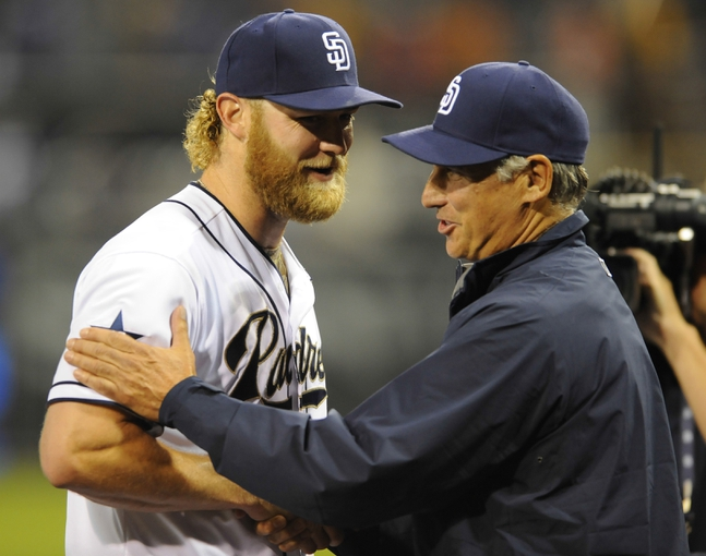 Apr 11, 2014; San Diego, CA, USA; San Diego Padres starting pitcher Andrew Cashner (34) is congratulated by manager Bud Black (20) after throwing a complete game one hitter against the Detroit Tigers at Petco Park. The Padres won 6-0. Mandatory Credit: Christopher Hanewinckel-USA TODAY Sports