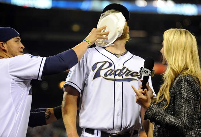 Apr 11, 2014; San Diego, CA, USA; San Diego Padres starting pitcher Andrew Cashner (34) is hit with shaving cream by catcher Yasmani Grandal (8) after throwing a complete game one hitter against the Detroit Tigers at Petco Park. The Padres won 6-0. Mandatory Credit: Christopher Hanewinckel-USA TODAY Sports
