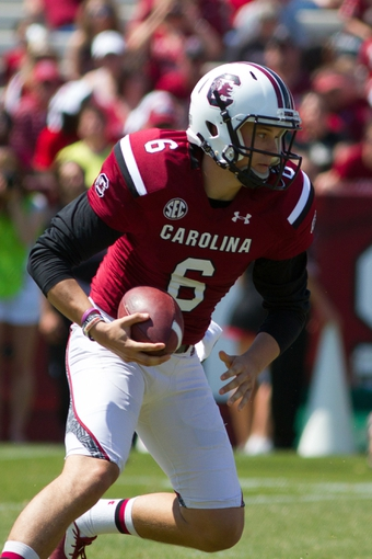 Apr 12, 2014; Columbia, SC, USA; South Carolina Gamecocks quarterback Conner Mitch (6) carries the ball during the first half of the South Carolina spring game at Williams-Brice Stadium. Mandatory Credit: Joshua S. Kelly-USA TODAY Sports