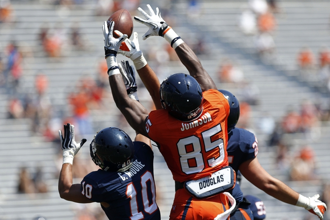 Apr 12, 2014; Charlottesville, VA, USA; Virginia Cavaliers wide receiver Keeon Johnson (85), cornerback C.J. Moore (10), and safety David Marrs (25) battle for the ball during the Cavaliers Spring Game at Scott Stadium. Mandatory Credit: Geoff Burke-USA TODAY Sports