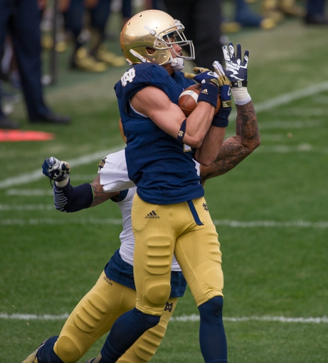Apr 12, 2014; Notre Dame, IN, USA; Notre Dame Fighting Irish wide receiver William Fuller (7) catches a pass as cornerback Josh Atkinson (24) defends in the first quarter of the Blue-Gold Game at Notre Dame Stadium. Mandatory Credit: Matt Cashore-USA TODAY Sports