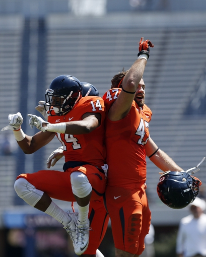 Apr 12, 2014; Charlottesville, VA, USA; Virginia Cavaliers wide receiver Andre Levrone (14) celebrates with Cavaliers fullback Vincent Croce (47) after scoring a touchdown during the Cavaliers Spring Game at Scott Stadium. Mandatory Credit: Geoff Burke-USA TODAY Sports