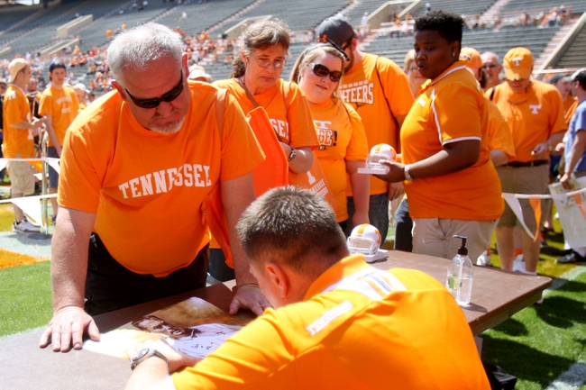 Apr 12, 2014; Knoxville, TN, USA; Tennessee Volunteers head coach Butch Jones signs autographs for fans before the orange and white spring game at Neyland Stadium. Mandatory Credit: Randy Sartin-USA TODAY Sports