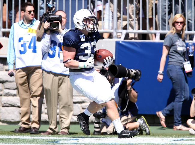 Apr 12, 2014; State College, PA, USA; Penn State Nittany Lions running back Cole Chiappialle (33) runs the ball into the end zone for a touchdown in the second quarter of the Blue White spring game at Beaver Stadium. Mandatory Credit: Matthew O'Haren-USA TODAY Sports