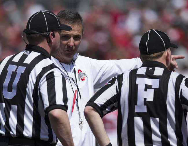 Apr 12, 2014; Columbus, OH, USA; Ohio State Buckeyes head coach Urban Meyer (M) talk with the officials during the Ohio State Buckeyes Spring Game at Ohio Stadium. Mandatory Credit: Greg Bartram-USA TODAY Sports