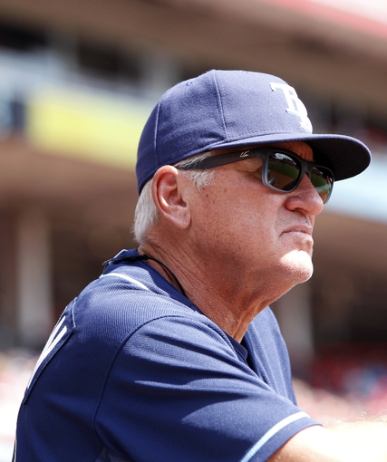 Apr 12, 2014; Cincinnati, OH, USA; Tampa Bay Rays manager Joe Maddon (70) during the third inning against the Cincinnati Reds at Great American Ball Park. Tampa defeated Cincinnati 1-0. Mandatory Credit: Frank Victores-USA TODAY Sports