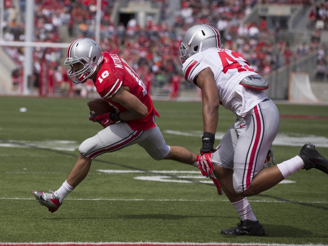 Apr 12, 2014; Columbus, OH, USA; Ohio State scarlet team wide receiver Kato Mitchell (18) tries to get into the end zone around Ohio State gray team linebacker Darron Lee (43) during the Ohio State Buckeyes spring game at Ohio Stadium. The scarlet team won the game 17-7. Mandatory Credit: Greg Bartram-USA TODAY Sports