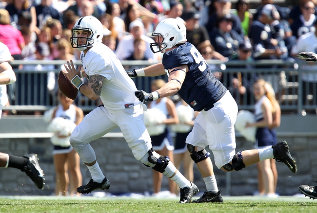 Apr 12, 2014; State College, PA, USA; Penn State Nittany Lions defensive end Garrett Sickels (90) sacks Penn State Nittany Lions quarterback D.J. Crook (17) in the third quarter of the Blue White spring game at Beaver Stadium. The Blue team won 37-0. Mandatory Credit: Matthew O'Haren-USA TODAY Sports