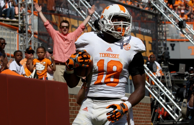 Apr 12, 2014; Knoxville, TN, USA; Tennessee Volunteers wide receiver Jason Croom (18) scores a touchdown during the orange and white spring game at Neyland Stadium. Mandatory Credit: Randy Sartin-USA TODAY Sports