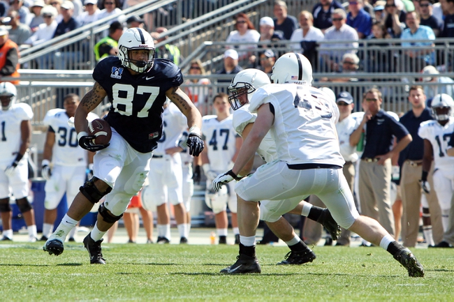 Apr 12, 2014; State College, PA, USA; Penn State Nittany Lions tight end Kyle Carter (87) runs with the ball in the fourth quarter of the Blue White spring game at Beaver Stadium. The Blue team defeated the White team 37-0. Mandatory Credit: Matthew O'Haren-USA TODAY Sports