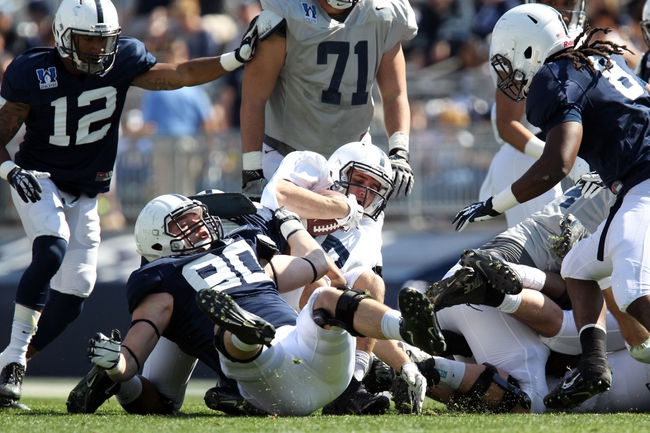 Apr 12, 2014; State College, PA, USA; Penn State Nittany Lions running back Adam Geiger (27) is tackled in the fourth quarter of the Blue White spring game at Beaver Stadium. The Blue team defeated the White team 37-0. Mandatory Credit: Matthew O'Haren-USA TODAY Sports