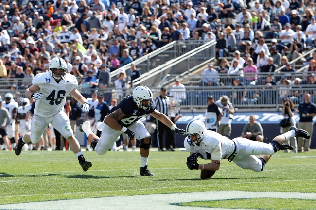 Apr 12, 2014; State College, PA, USA; Penn State Nittany Lions safety Jordan Dudas (34) attempts to intercept the ball intended for Penn State Nittany Lions tight end Kyle Carter (87) in the fourth quarter of the Blue White spring game at Beaver Stadium. The Blue team defeated the White team 37-0. Mandatory Credit: Matthew O'Haren-USA TODAY Sports