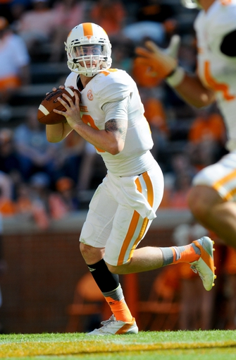 Apr 12, 2014; Knoxville, TN, USA; Tennessee Volunteers quarterback Riley Ferguson (10) looks to throw the ball during the spring game at Neyland Stadium. Mandatory Credit: Randy Sartin-USA TODAY Sports