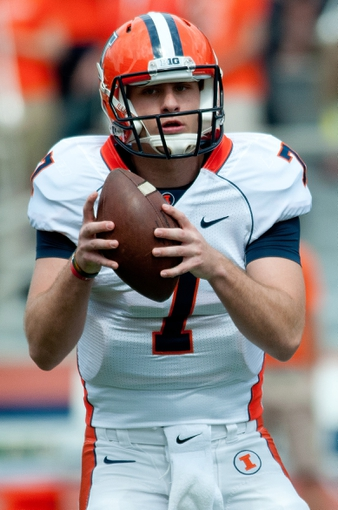 Apr 12, 2014; Champaign, IL, USA; Illinois Fighting Illini quarterback Chayce Crouch holds the ball during the second quarter of the spring game at Memorial Stadium. Mandatory Credit: Bradley Leeb-USA TODAY Sports