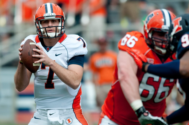 Apr 12, 2014; Champaign, IL, USA; Illinois Fighting Illini quarterback Chayce Crouch looks to pass the ball during the second quarter of the spring game at Memorial Stadium. Mandatory Credit: Bradley Leeb-USA TODAY Sports