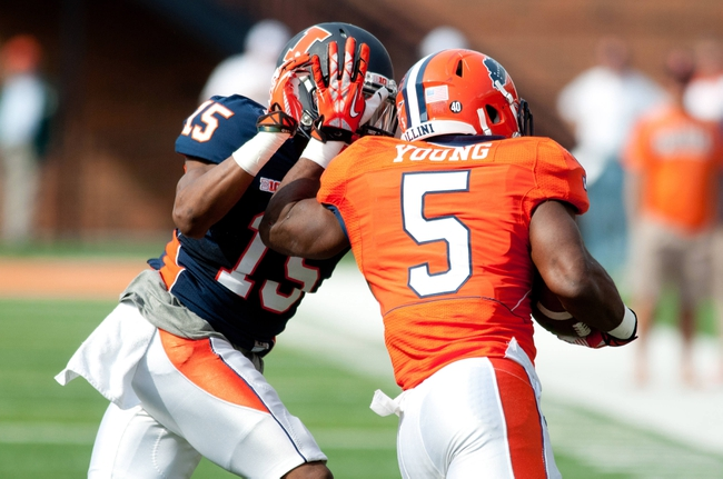 Apr 12, 2014; Champaign, IL, USA; Illinois Fighting Illini running back Donovonn Young (5) runs with the ball as defensive back Jevaris Little (15) defends during the third quarter of the spring game at Memorial Stadium. Mandatory Credit: Bradley Leeb-USA TODAY Sports