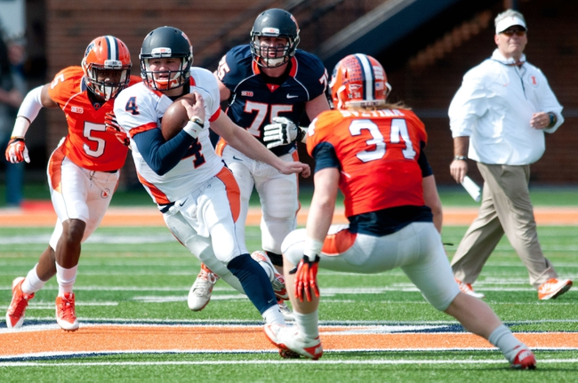 Apr 12, 2014; Champaign, IL, USA; Illinois Fighting Illini quarterback Reilly O'Toole runs with the ball as linebacker Mike Svetina (34) defends during the third quarter of the spring game at Memorial Stadium. Mandatory Credit: Bradley Leeb-USA TODAY Sports