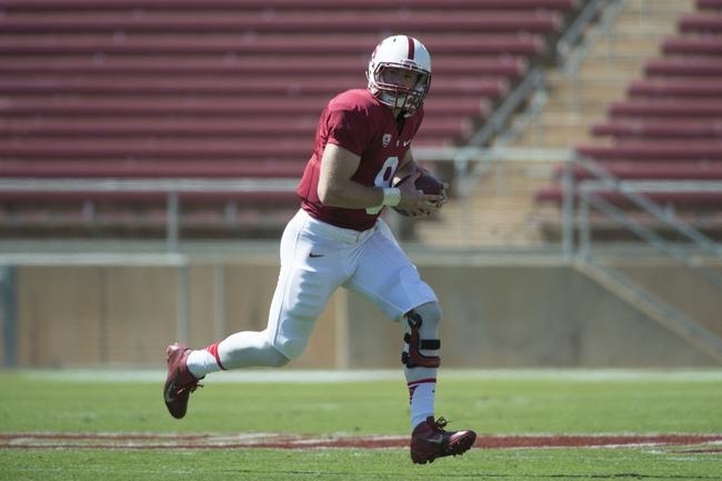 April 12, 2014; Stanford, CA, USA; Stanford Cardinal quarterback Kevin Hogan (8) runs with the football during the spring game at Stanford Stadium. Mandatory Credit: Kyle Terada-USA TODAY Sports