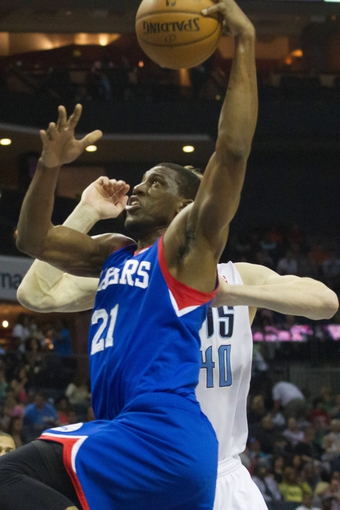 Apr 12, 2014; Charlotte, NC, USA; Philadelphia 76ers forward Thaddeus Young (21) goes up for a shot against the Charlotte Bobcats during the first half at Time Warner Cable Arena. Mandatory Credit: Jeremy Brevard-USA TODAY Sports
