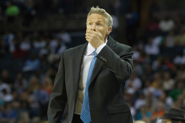 Apr 12, 2014; Charlotte, NC, USA; Philadelphia 76ers head coach Brett Brown reacts to a call during the first half against the Charlotte Bobcats at Time Warner Cable Arena. Mandatory Credit: Jeremy Brevard-USA TODAY Sports