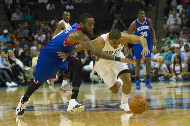 Apr 12, 2014; Charlotte, NC, USA; Philadelphia 76ers guard Tony Wroten (8) and Charlotte Bobcats guard Gary Neal (12) chase after a loose ball during the first half at Time Warner Cable Arena. Mandatory Credit: Jeremy Brevard-USA TODAY Sports