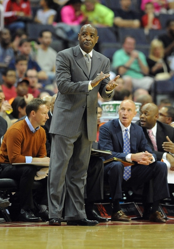 Apr 12, 2014; Washington, DC, USA; Milwaukee Bucks head coach Larry Drew reacts against the Washington Wizards during the first half at Verizon Center. Mandatory Credit: Brad Mills-USA TODAY Sports