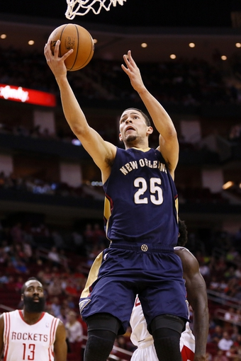 Apr 12, 2014; Houston, TX, USA; New Orleans Pelicans guard Austin Rivers (25) shoots the ball during the first half against the Houston Rockets at Toyota Center. Mandatory Credit: Soobum Im-USA TODAY Sports
