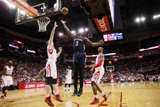 Apr 12, 2014; Houston, TX, USA; New Orleans Pelicans guard Anthony Morrow (3) shoots the ball over Houston Rockets center Omer Asik (left) during the first half at Toyota Center. Mandatory Credit: Soobum Im-USA TODAY Sports