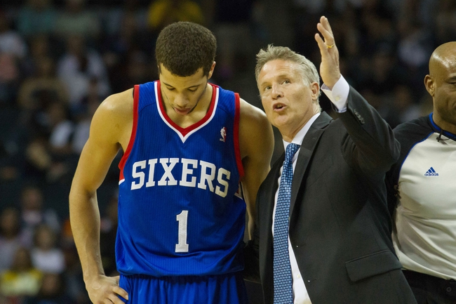 Apr 12, 2014; Charlotte, NC, USA; Philadelphia 76ers head coach Brett Brown talks with guard Michael Carter-Williams (1) during the second half against the Charlotte Bobcats at Time Warner Cable Arena. The Bobcats defeated the 76ers 111-105. Mandatory Credit: Jeremy Brevard-USA TODAY Sports