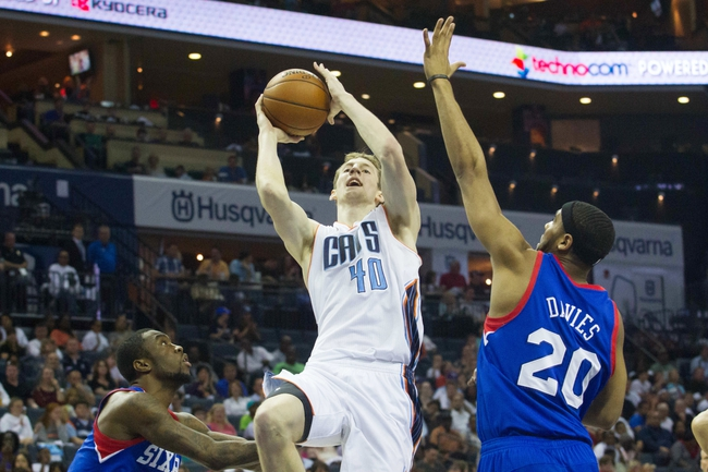 Apr 12, 2014; Charlotte, NC, USA; Charlotte Bobcats center Cody Zeller (40) shoots the ball over Philadelphia 76ers forward Brandon Davies (20) during the second half at Time Warner Cable Arena. The Bobcats defeated the 76ers 111-105. Mandatory Credit: Jeremy Brevard-USA TODAY Sports