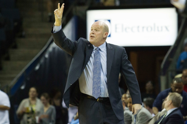 Apr 12, 2014; Charlotte, NC, USA; Charlotte Bobcats head coach Steve Clifford calls out during the second half ag