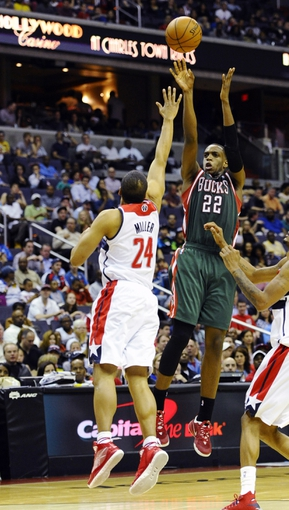 Apr 12, 2014; Washington, DC, USA; Milwaukee Bucks power forward Khris Middleton (22) shoots over Washington Wizards point guard Andre Miller (24) during the second half at Verizon Center. The Wizards won 104-91. Mandatory Credit: Brad Mills-USA TODAY Sports