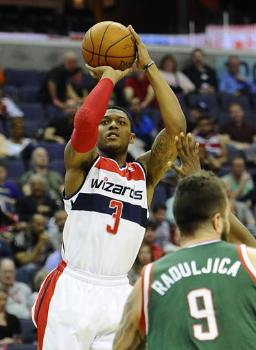Apr 12, 2014; Washington, DC, USA; Washington Wizards shooting guard Bradley Beal (3) shoots a jump shot over Milwaukee Bucks center Miroslav Raduljica (9) during the first half at Verizon Center. Mandatory Credit: Brad Mills-USA TODAY Sports