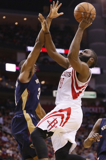Apr 12, 2014; Houston, TX, USA; Houston Rockets guard James Harden (13) shoots as New Orleans Pelicans guard Anthony Morrow (3) defends during the second half at Toyota Center. The Rockets won 111-104. Mandatory Credit: Soobum Im-USA TODAY Sports