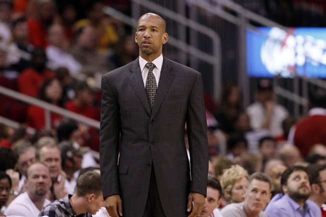 Apr 12, 2014; Houston, TX, USA; New Orleans Pelicans head coach Monty Williams watches from the sideline during the first half against the Houston Rockets at Toyota Center. Mandatory Credit: Soobum Im-USA TODAY Sports