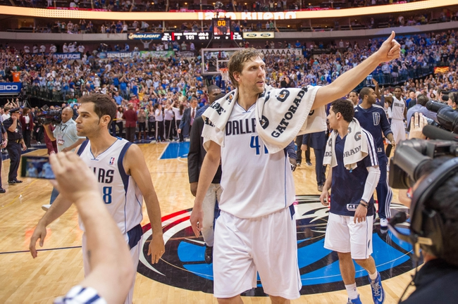 Apr 12, 2014; Dallas, TX, USA; Dallas Mavericks forward Dirk Nowitzki (41) and his team celebrate the win over the Phoenix Suns at the American Airlines Center. The Mavericks defeated the Suns 101-98 and clinched a spot in the NBA playoffs. Mandatory Credit: Jerome Miron-USA TODAY Sports
