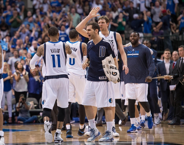 Apr 12, 2014; Dallas, TX, USA; The Dallas Mavericks celebrate taking the lead over the Phoenix Suns during the second half at the American Airlines Center. The Mavericks defeated the Suns 101-98 and clinched a spot in the NBA playoffs. Mandatory Credit: Jerome Miron-USA TODAY Sports