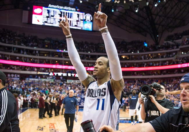 Apr 12, 2014; Dallas, TX, USA; Dallas Mavericks guard Monta Ellis (11) and his team celebrate the win over the Phoenix Suns at the American Airlines Center. The Mavericks defeated the Suns 101-98 and clinched a spot in the NBA playoffs. Mandatory Credit: Jerome Miron-USA TODAY Sports