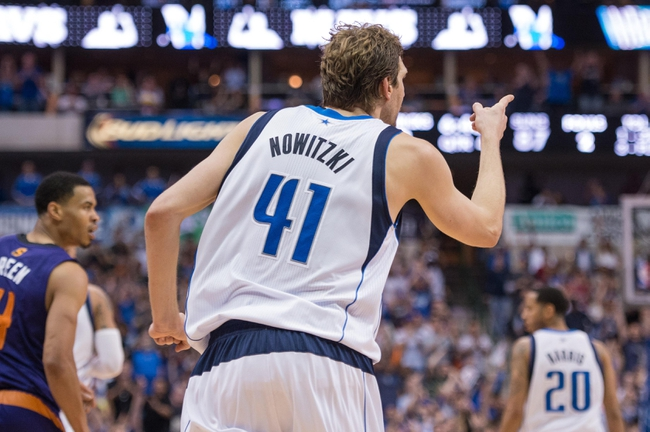 Apr 12, 2014; Dallas, TX, USA; Dallas Mavericks forward Dirk Nowitzki (41) celebrates making a jump shot against the Phoenix Suns during the second half at the American Airlines Center. The Mavericks defeated the Suns 101-98 and clinched a spot in the NBA playoffs. Mandatory Credit: Jerome Miron-USA TODAY Sports