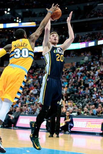 Apr 12, 2014; Denver, CO, USA; Denver Nuggets small forward Quincy Miller (30) guards Utah Jazz shooting guard Gordon Hayward (20) in the third quarter at the Pepsi Center. The Nuggets won 101-94. Mandatory Credit: Isaiah J. Downing-USA TODAY Sports