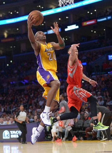 Apr 8, 2014; Los Angeles, CA, USA; Los Angeles Lakers guard Jodie Meeks (20) is defended by Houston Rockets guard Jeremy Lin (7) at Staples Center. Mandatory Credit: Kirby Lee-USA TODAY Sports