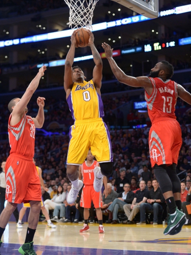 Apr 8, 2014; Los Angeles, CA, USA; Los Angeles Lakers guard Nick Young (0) is defended by Houston Rockets forward Francisco Garcia (32) and guard James Harden (13) at Staples Center. Mandatory Credit: Kirby Lee-USA TODAY Sports